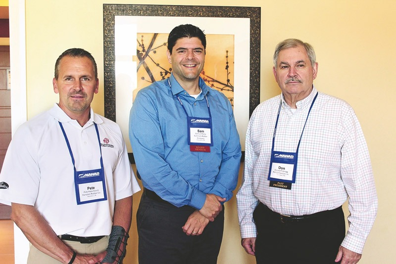 Pete Haberbosch, Sam Petillo and Don Fritzinger stand wearing their NAHAD ID tags in promotion of their nationalized Onguard Hose Safety and Onguard Asset Management program, as well as Singer Equities decentralized approach at hose, conveyor belt and rubber distribution.